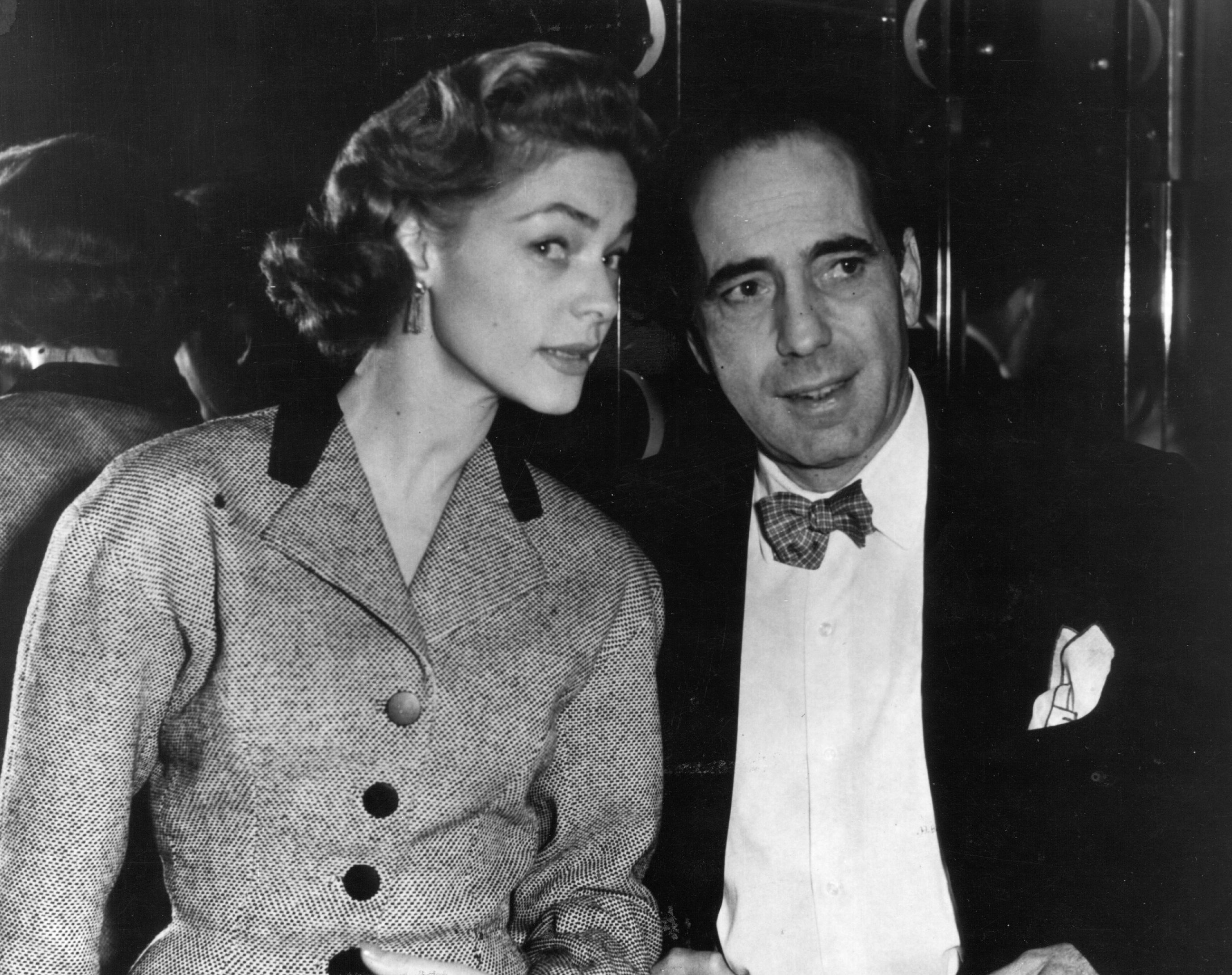 Humphrey De Forest Bogart (1899 - 1957), American film actor with his wife Lauren Bacall, originally Betty Joan Perske, an American actress, in 1951. | Source: Getty Images