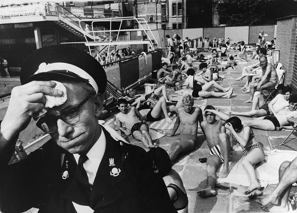 An ambulance man on duty at the Holborn Oasis swimming pool, London, suffering in the July heat   Source: Getty Images