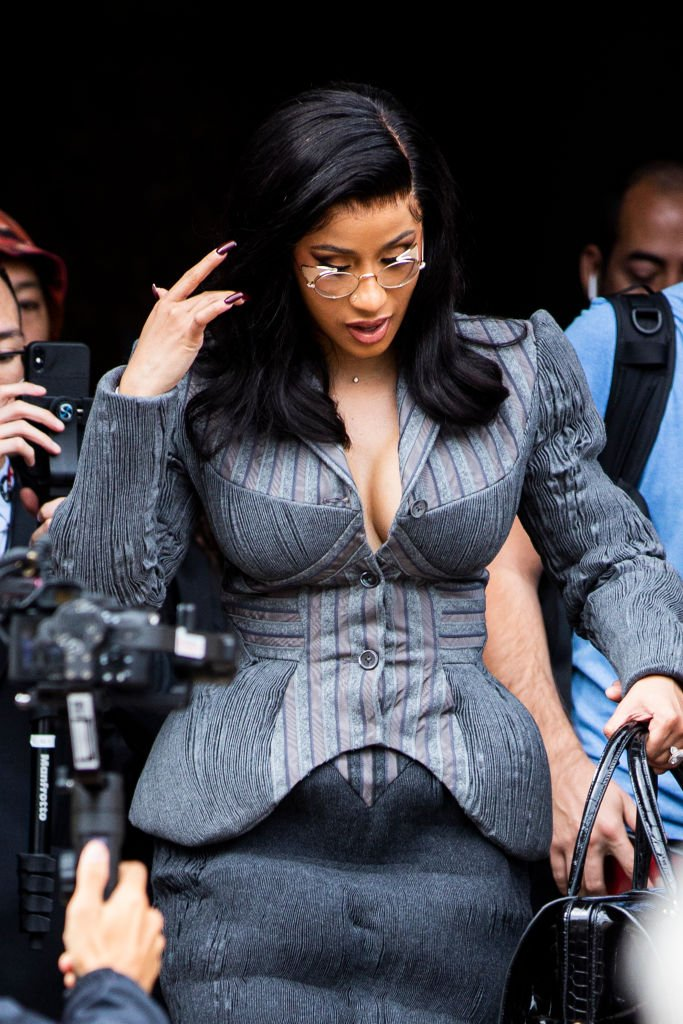 Cardi B, wearing a grey decorated blazer, is seen outside the Thom Browne show during Paris Fashion Week - Womenswear Spring Summer 2020 | Photo: GEtty Images