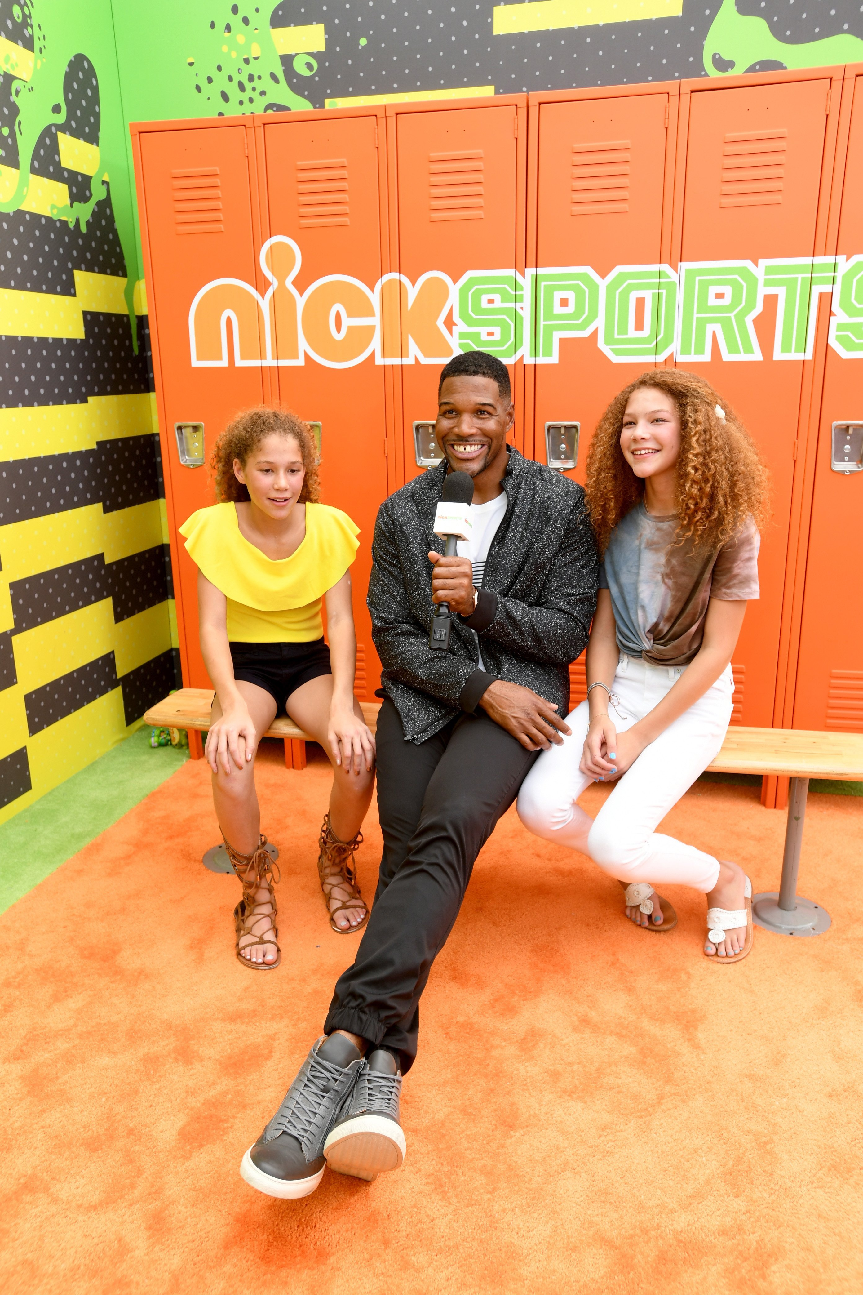 Michael Strahan and his twin daughters, Sophia and Isabella. | Source: Getty Images