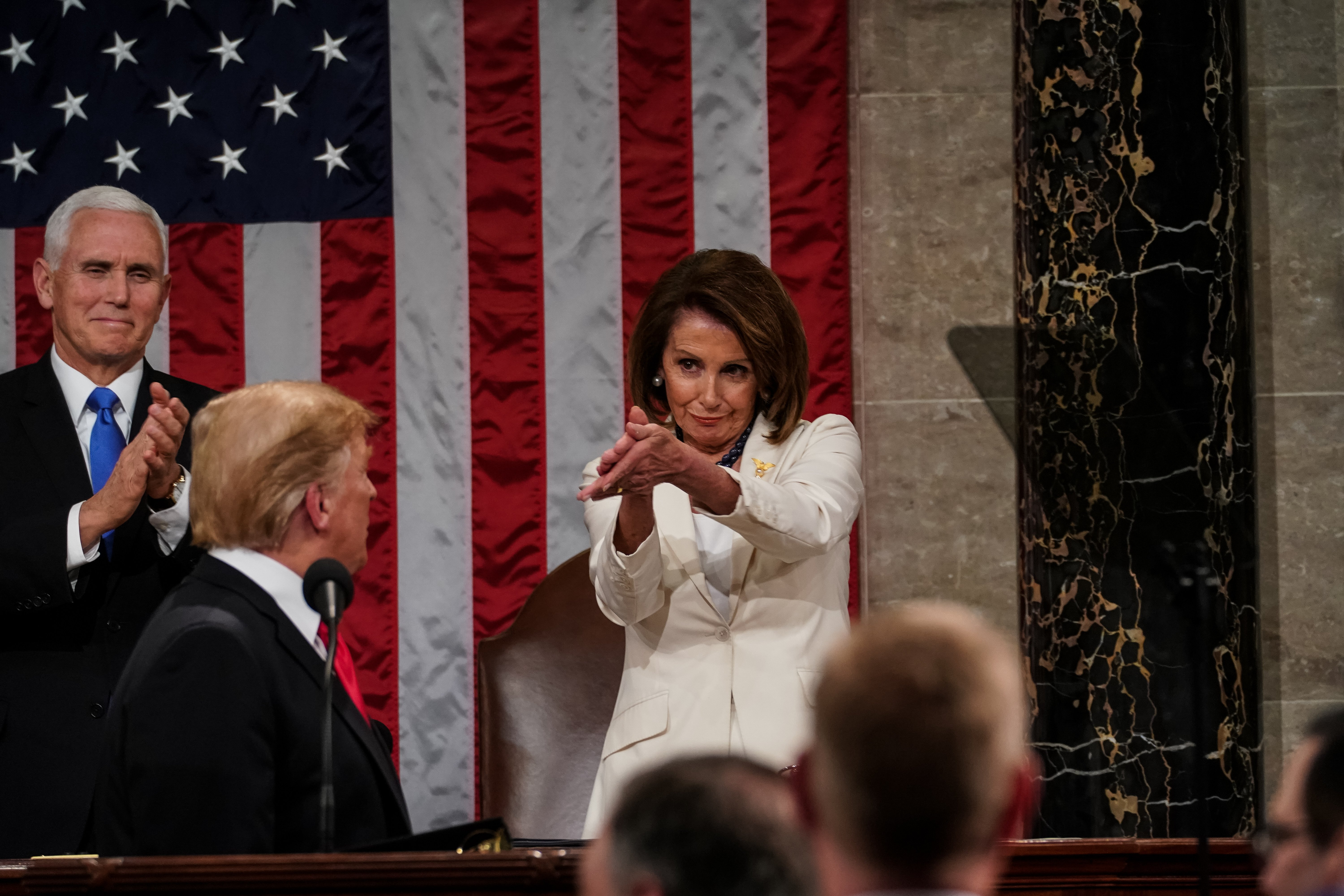 President Donald Trump giving his State of the Union Speech with Nancy Pelosi applauding him in February 2019 | Photo: Getty Images