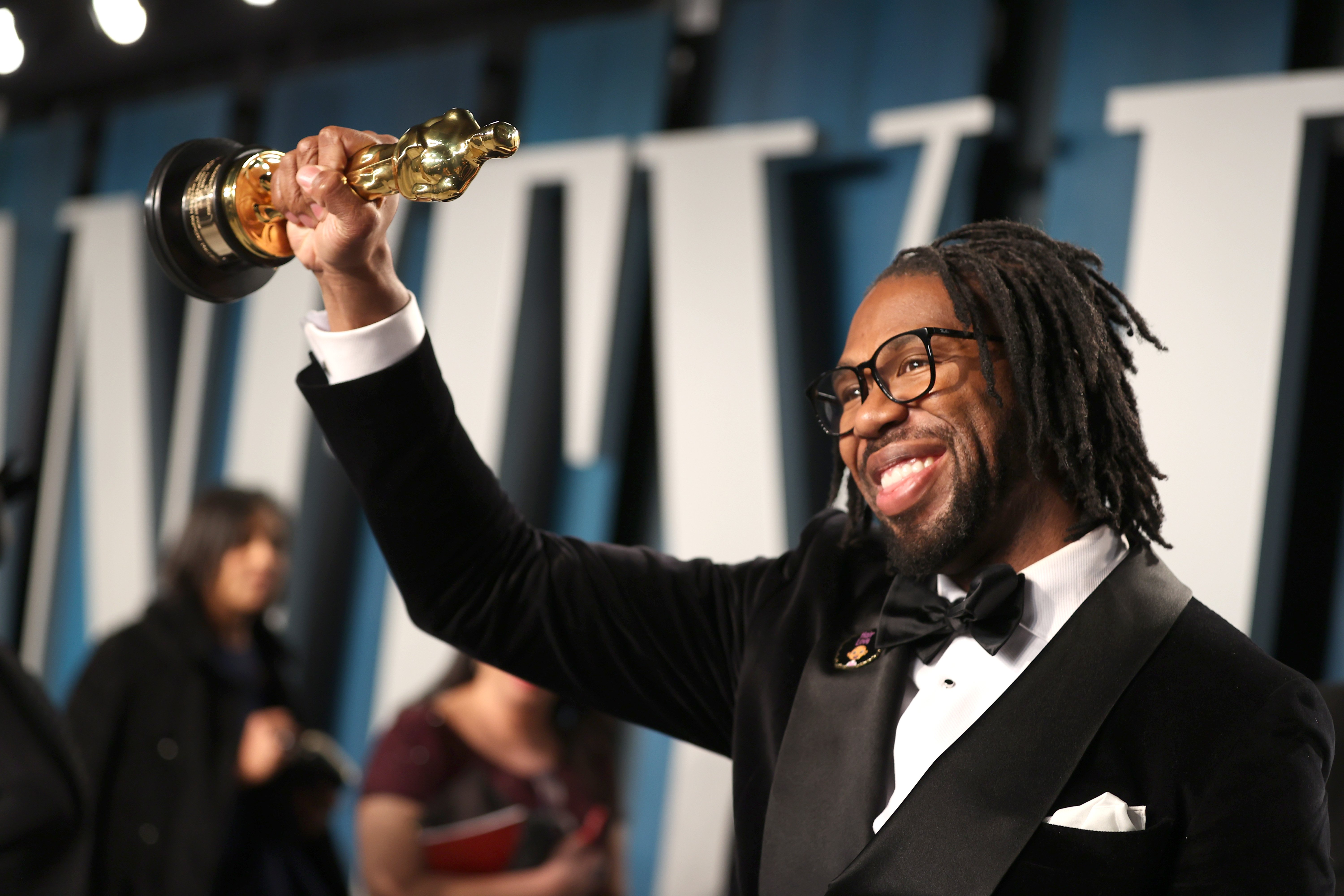 """Matthew A. Cherry posed with the Oscar for Best Animated Short Film for """"Hair Love"""" at the 2020 Vanity Fair Oscar Party. 