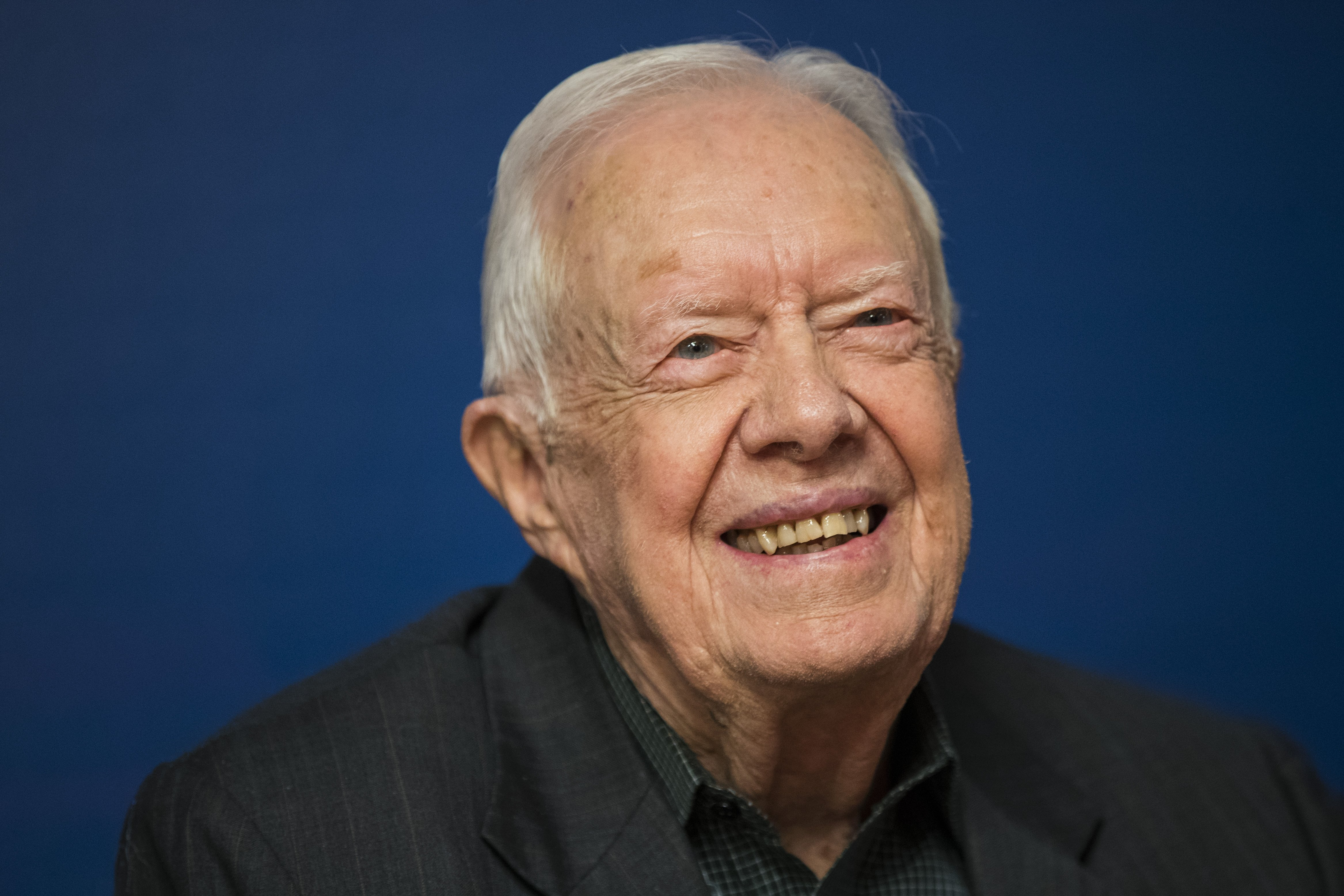Jimmy Carter smiles during a book signing event for his new book 'Faith: A Journey For All' at Barnes & Noble bookstore in Midtown Manhattan, March 26, 2018, in New York City. | Source: Getty Images.