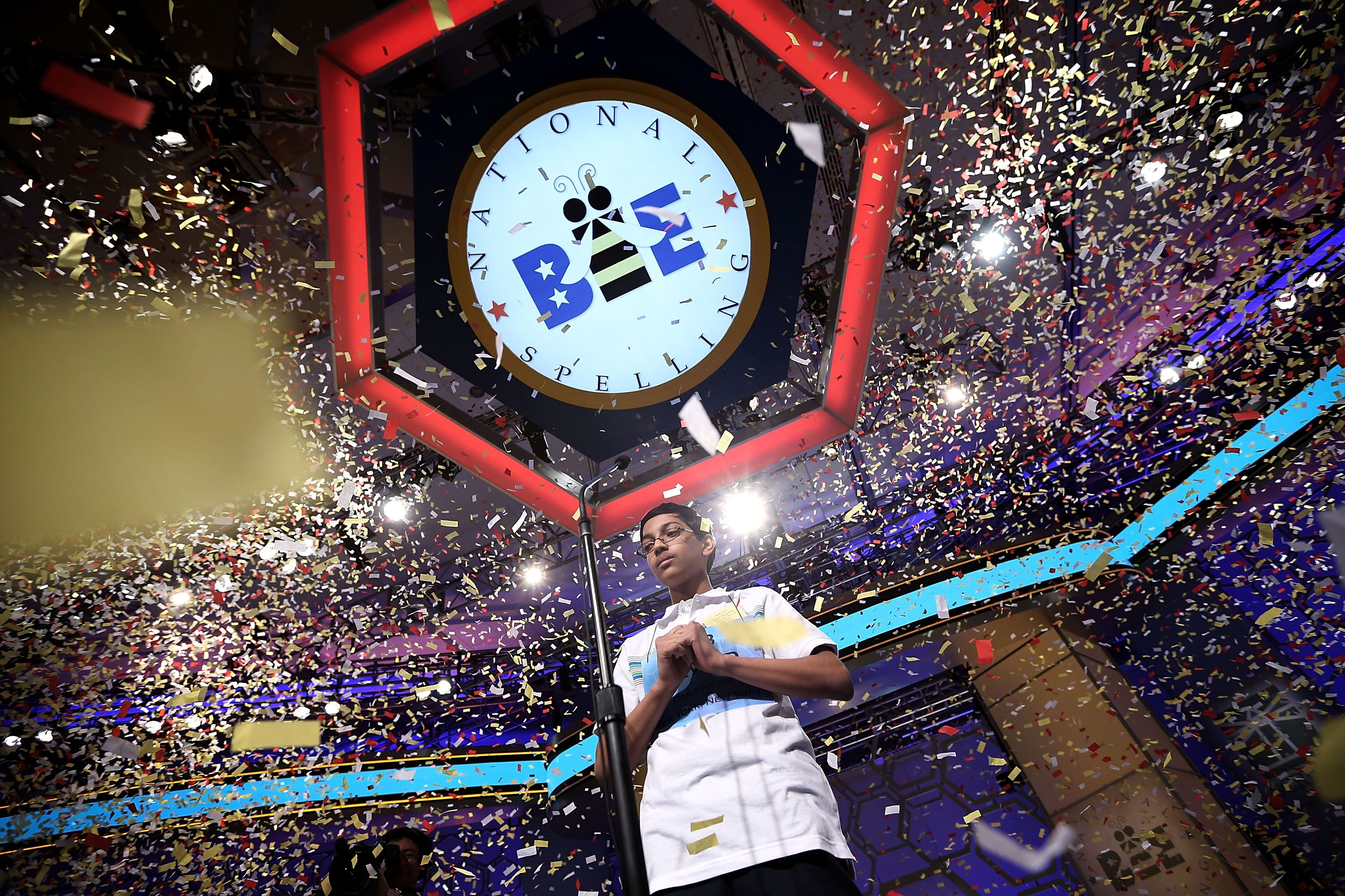 Confetti falls over Arvind Mahankali of Bayside Hills, New York after the finals of the 2013 Scripps National Spelling Bee May 30, 2013 at Gaylord National Resort, Maryland | Photo: Getty Images