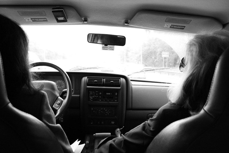 Two women together on a car ride. | Photo: Flickr