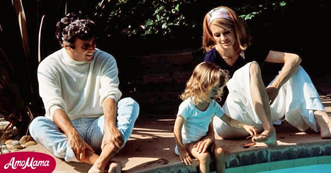 Burt Bacharach, wife Angie Dickinson, and daughter Lea Nikki, 2, on the grounds and around the swimming pool of their Hollywood home June 3, 1969.   Source: Getty Images