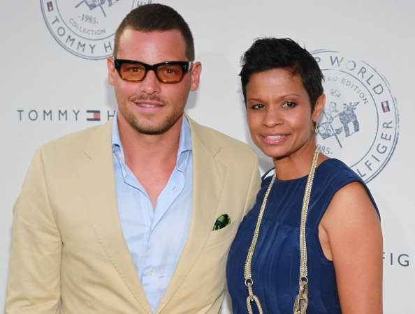 """Actor Justin Chambers (L) and wife Keisha Chambers attend the launch party for Tommy Hilfiger's """"Prep World Pop Up House"""" at The Grove 