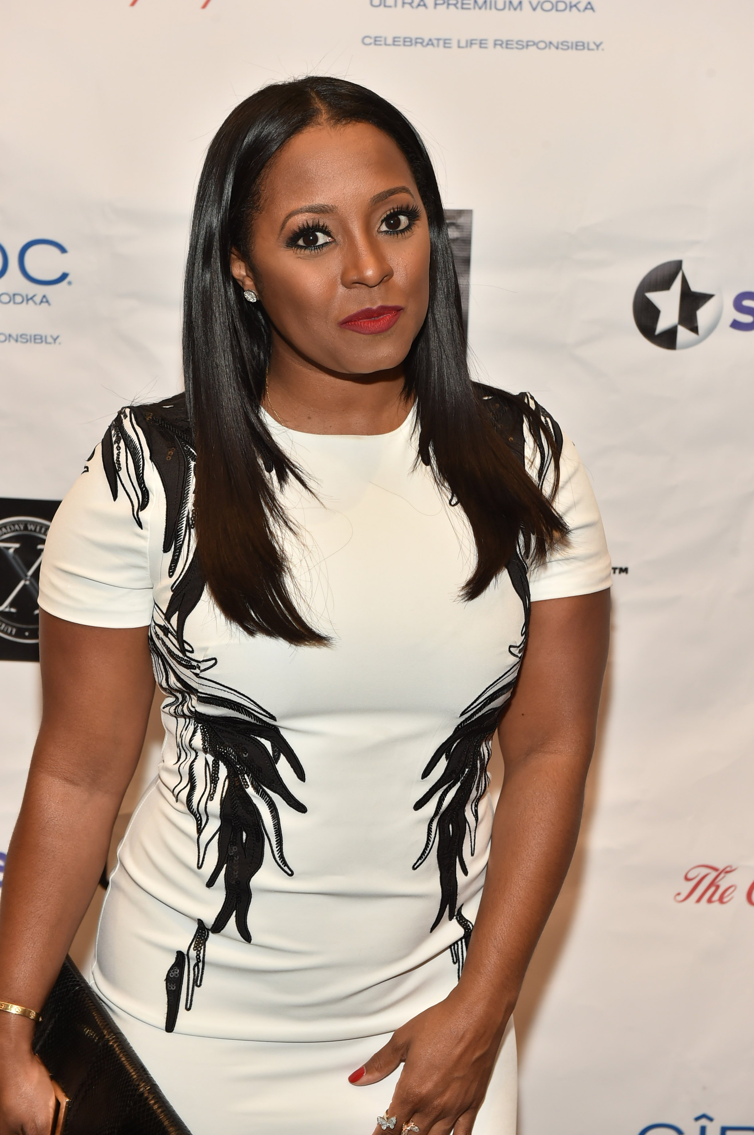 """Keshia Knight Pulliam poses at """"The Red Napkin"""" dinner at the Coca-Cola Headquarters on September 4, 2015 in Atlanta, Georgia. 