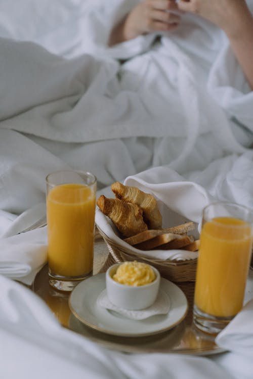 Juice and pastries served in bed | Source: Pexels