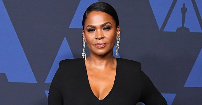 Nia Long's Curly-Haired Son Kez Is All Smiles Posing in a Black T-Shirt with a Book (Photo)