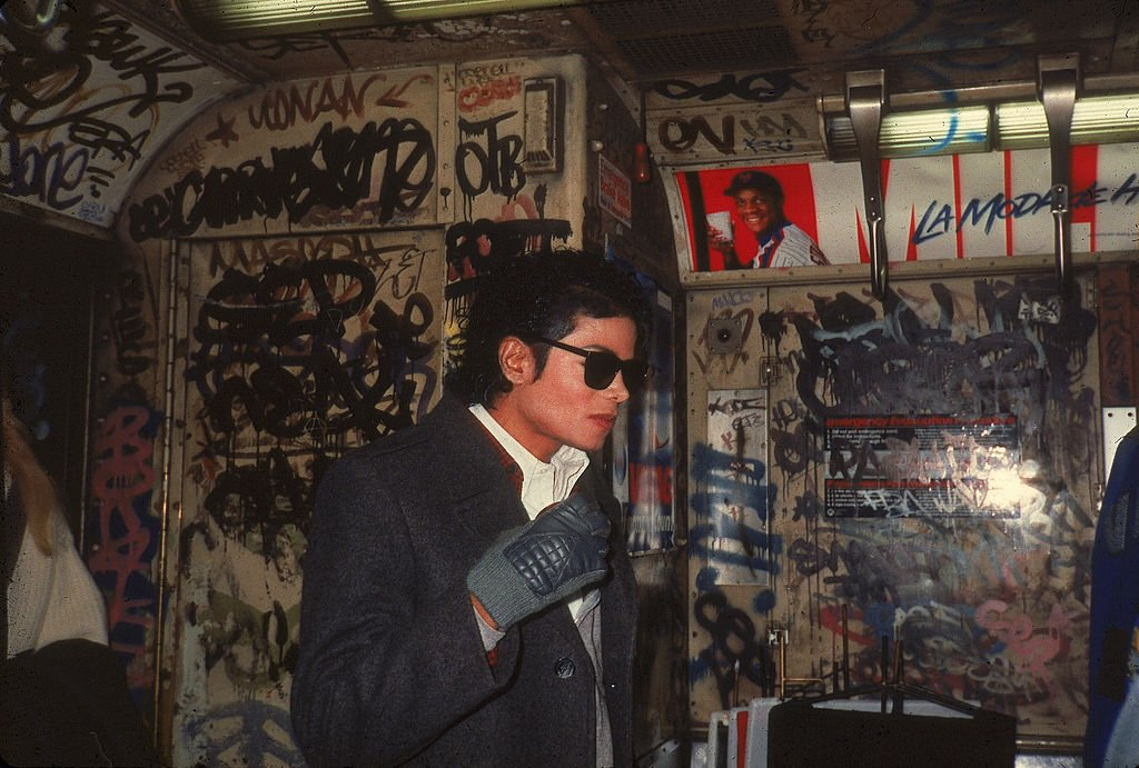 American musician Michael Jackson (1958 - 2009) stands in a graffiti-filled subway car during the filming of the long-form music video for his song 'Bad,' directed by Martin Scorsese, New York, New York, November 1986. | Source: Getty Images
