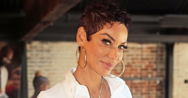 Nicole Murphy Stuns in a Swimsuit with Her Skin Glowing While Sunbathing in a New Photo