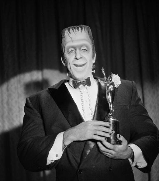 Herman Munster with an award trophy in a still from the CBS television situation comedy 'The Munsters' | Photo: Getty Images