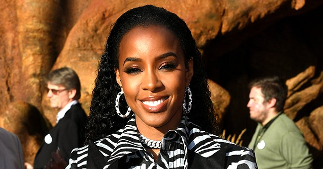See Kelly Rowland's Gorgeous New Pics Wearing a Dazzling Low-Cut Dress Featuring a Slit
