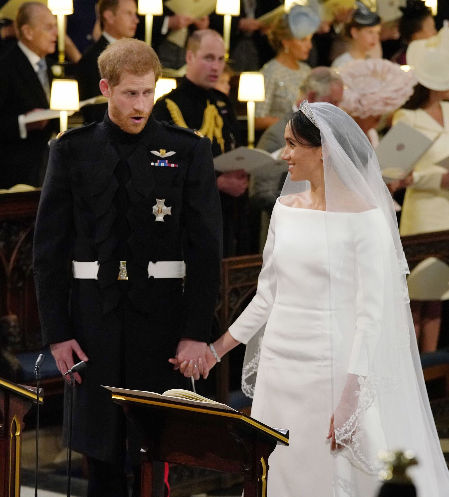 Prince Harry stands with his bride, Meghan Markle, during their wedding in St George's Chapel at Windsor Castle  | Getty Images