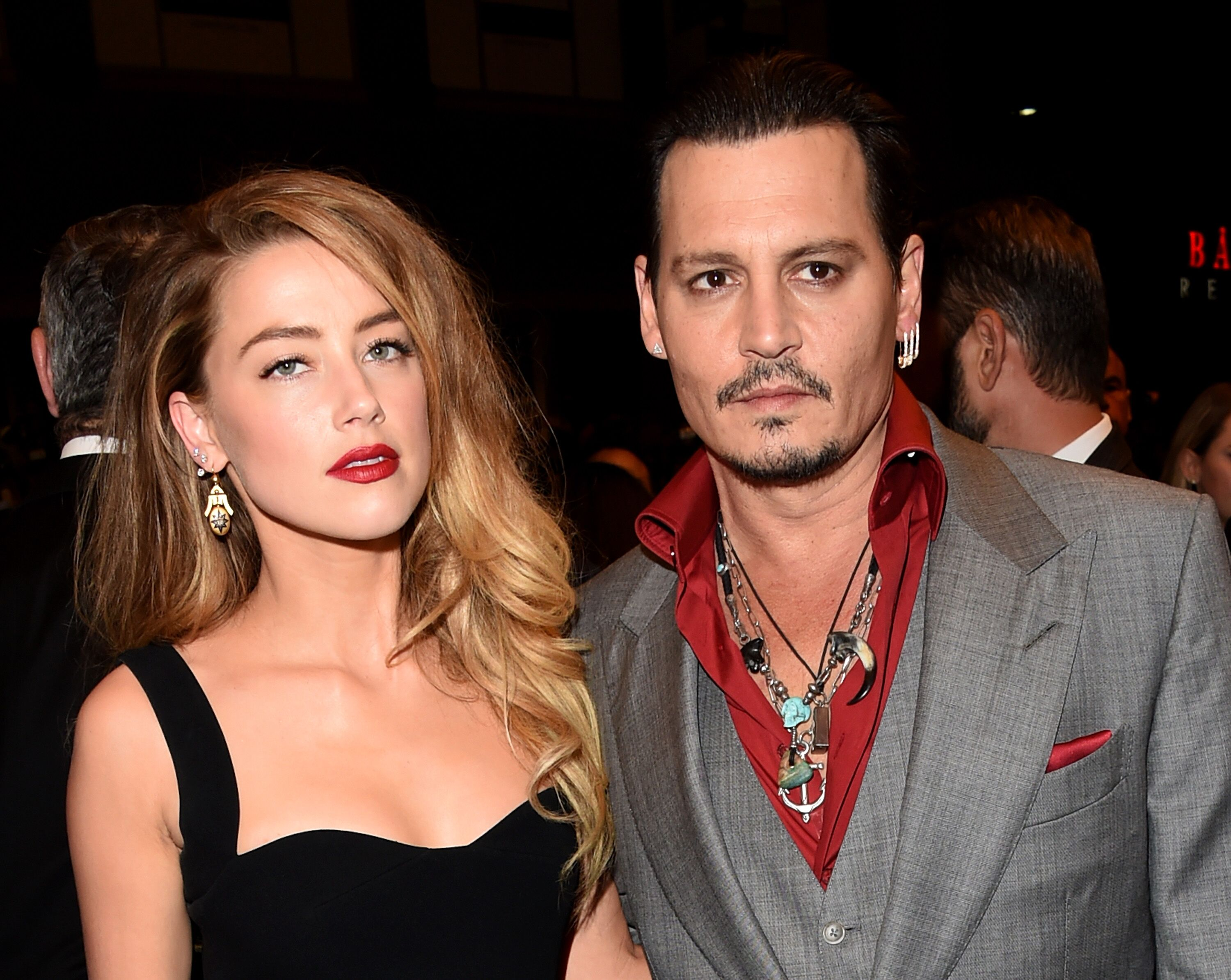 "Amber Heard and Johnny Depp attend the ""Black Mass"" premiere during the 2015 Toronto International Film Festival. 
