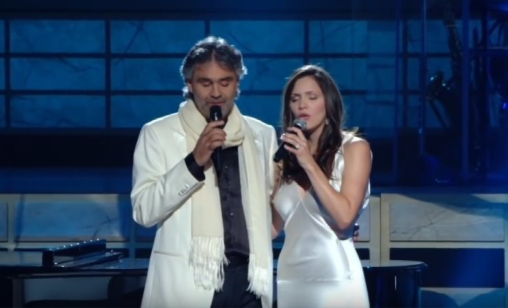 "Andrea Bocelli and Katharine McPhee performing a duet with their rendition of ""The Prayer."" 