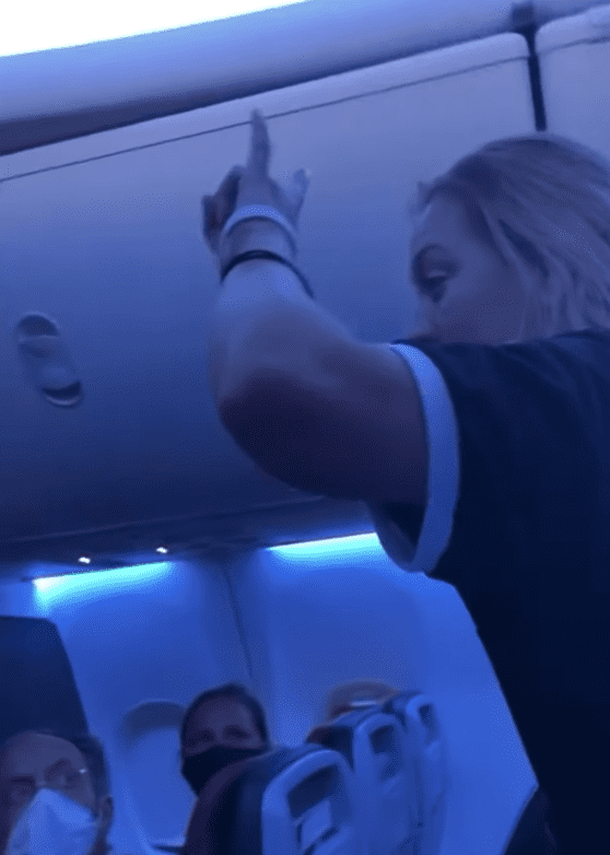 In a viral YouTube video a woman on a plane causes commotion as she shouts at fellow passengers | Photo: Youtube/Jackson VanHoose