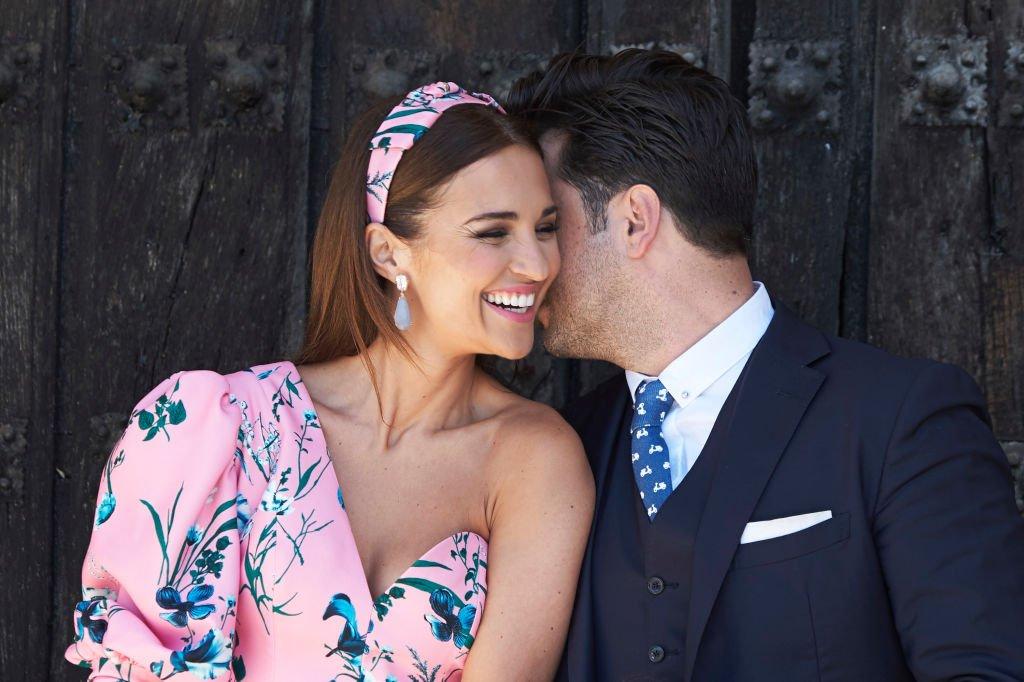 Paula Echevarría y David Bustamante sonriendo.| Fuente: Getty Images