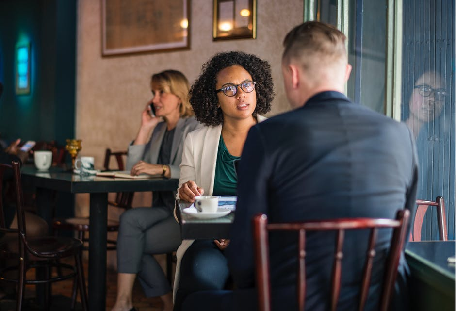 A woman looking at a man during a coffee date. | Source: Pexels