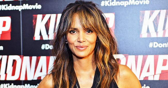 Fans Praise Halle Berry for Showing Her Long Legs in Chic Heels & Purple Blouse — See Comments