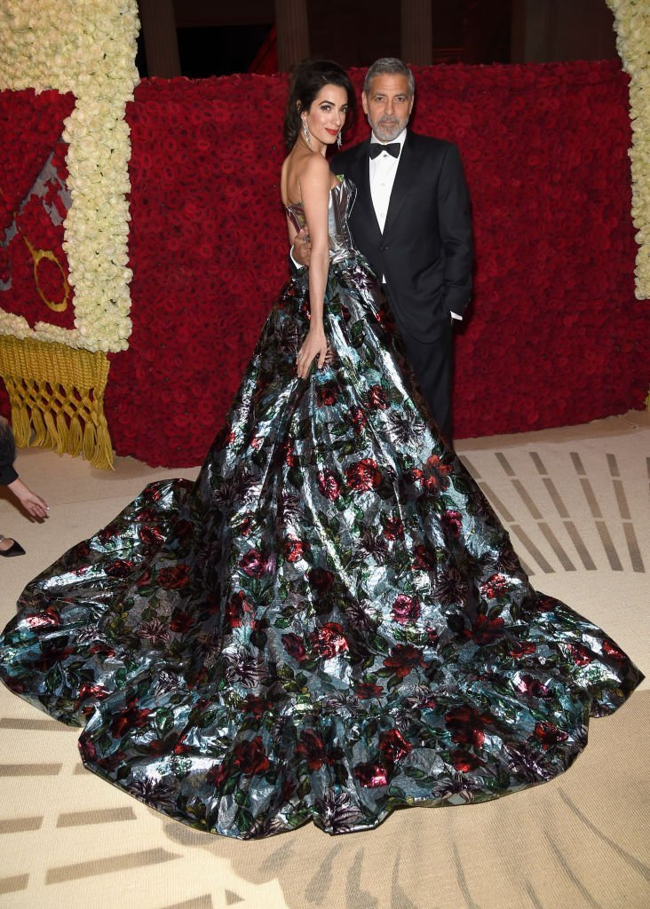 2018 Met Gala Host, Amal Clooney and George Clooney attend the Heavenly Bodies: Fashion & The Catholic Imagination Costume Institute Gala at The Metropolitan Museum of Art | Getty Images