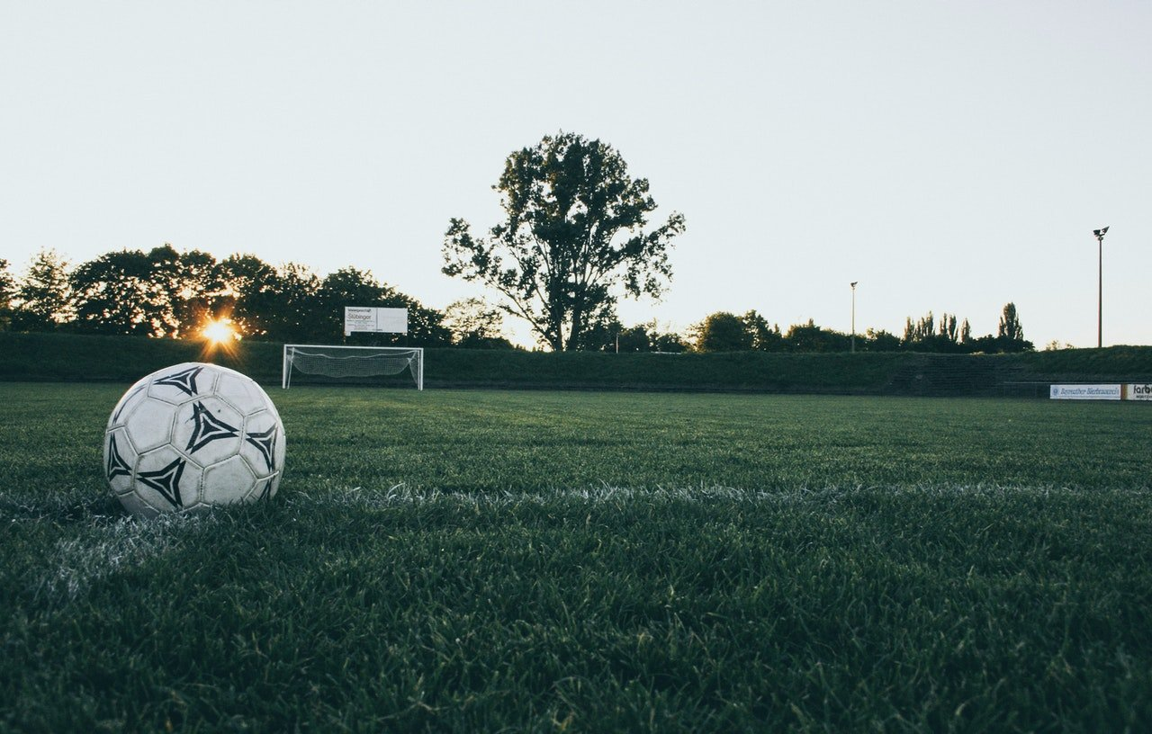 Photo of a football on a pitch | Photo: Pexels