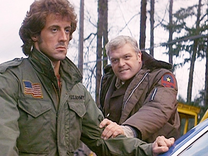 """Sylvester Stallone as John Rambo, and Brian Dennehy as Sheriff Will Teasle in """"First Blood"""" released in October 1982   Photo: Getty Images"""