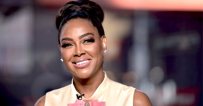 Kenya Moore's Daughter Brooklyn Plays with a Little Doll in an Adorable New Picture