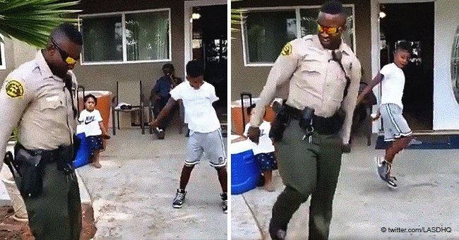 Accidental 911 call leads to epic dance battle between boy and police officer