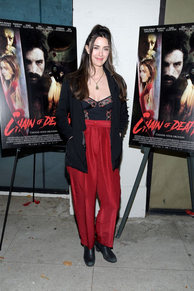 "Actress Madeline Zima attends the Los Angeles premiere of Cleopatra Entertainment's ""Chain Of Death"" at Laemmle Music Hall on July 19, 2019 