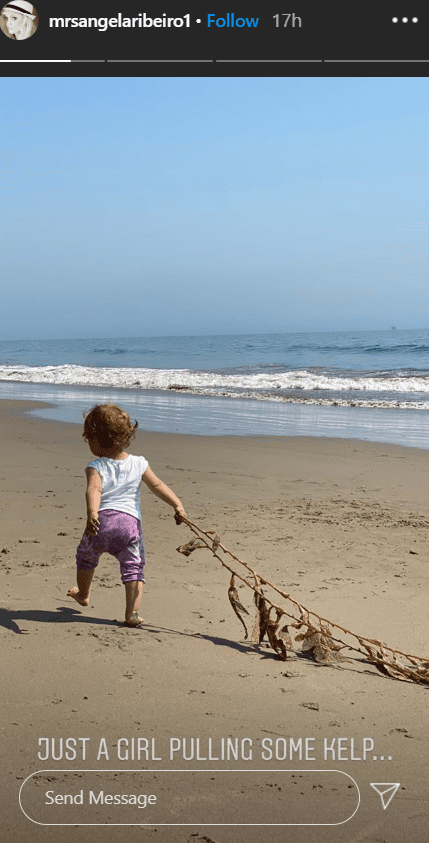 A picture of Alfonso Riberio's daughter, Ava, dragging a kelp across the ground on a beach. | Photo: Instagram/@mrsangelaribeiro1