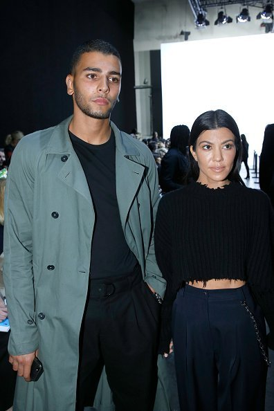 Kourtney Kardashian (L) and her companion Younes Bendjima (R) attend the Haider Ackermann show as part of the Paris Fashion Week Womenswear Spring/Summer 2018 on September 30, 2017 in Paris, France | Photo: Getty Images
