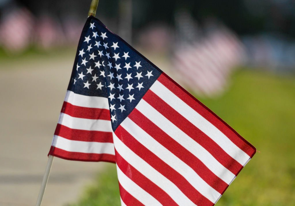A picture of flags put out by Wilson High School JROTC members on September 11, 2020. | Photo: Getty Images.