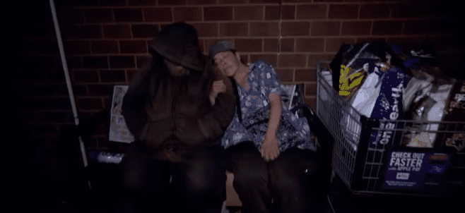Suzan Lewis and a friend David sleeping on a metal bench in Philadelphia in 2017   Photo: YouTube/Inside Edition
