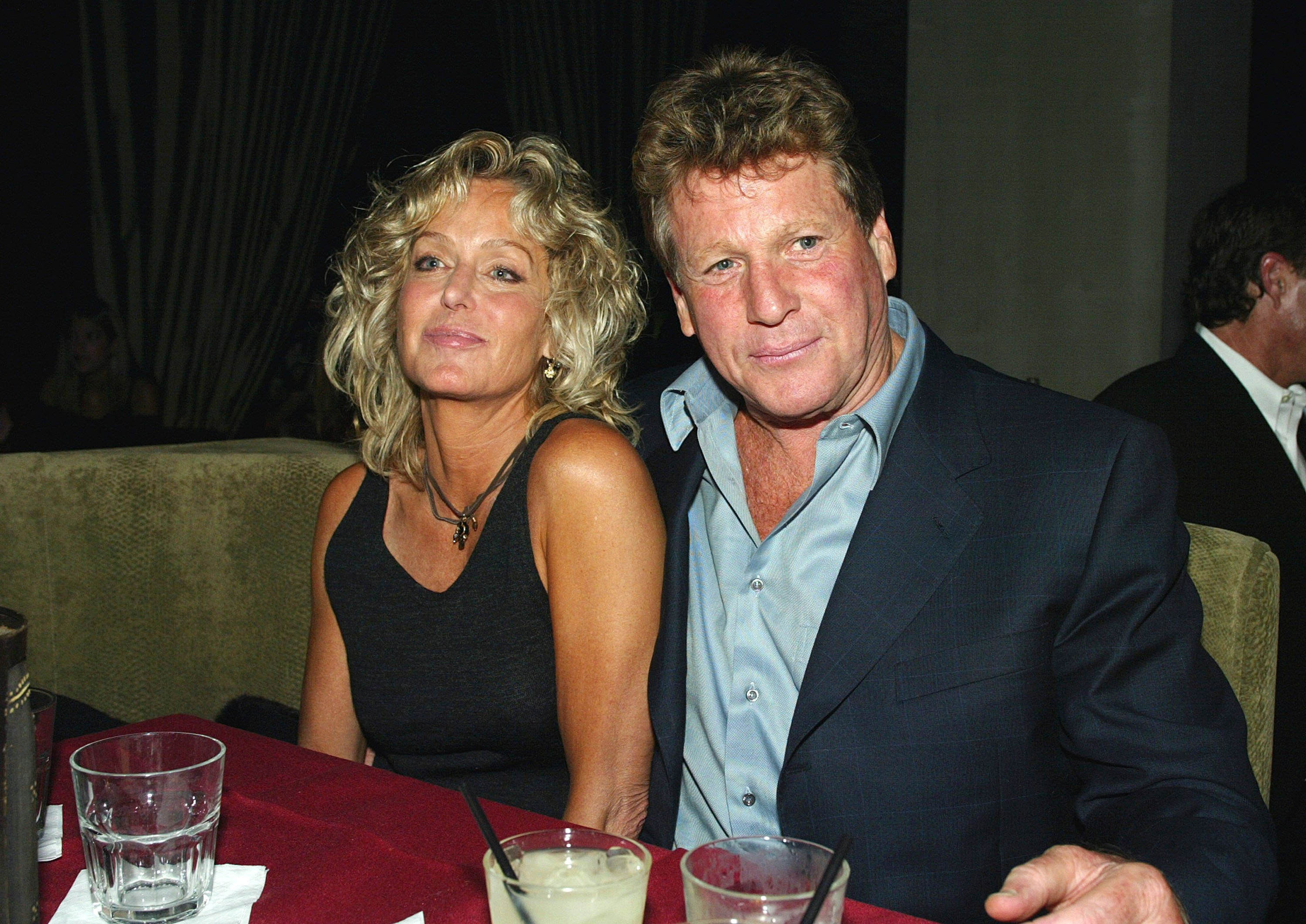 "Actors Farrah Fawcett (L) and Ryan O'Neal relax at the after-party for ""Malibu's Most Wanted"" at the Highlands on April 10, 2003, in Los Angeles, California. 