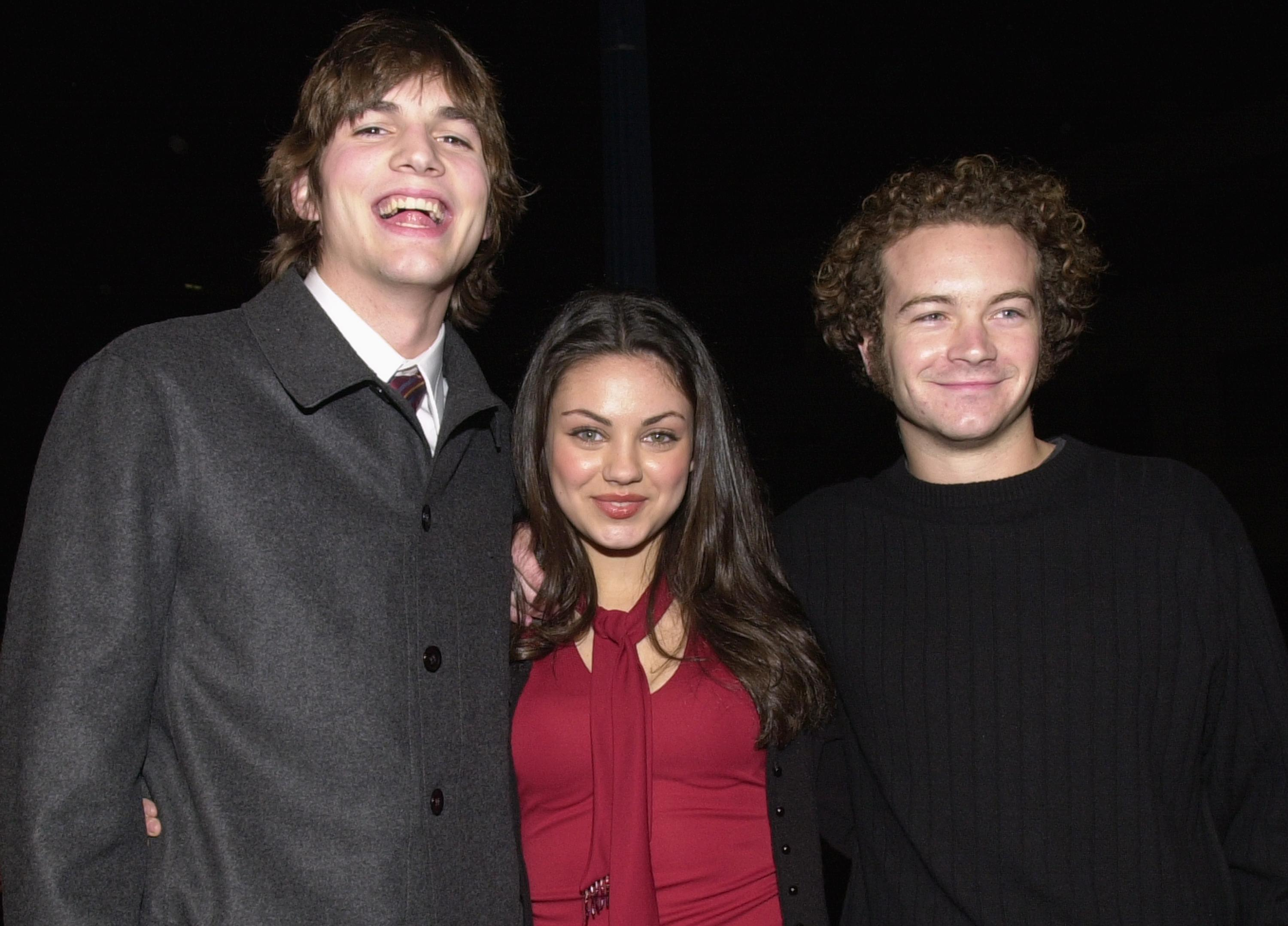 "Ashton Kutcher, Mila Kunis, and Danny Masterson at the premiere of ""Traffic"" December 14, 2000 