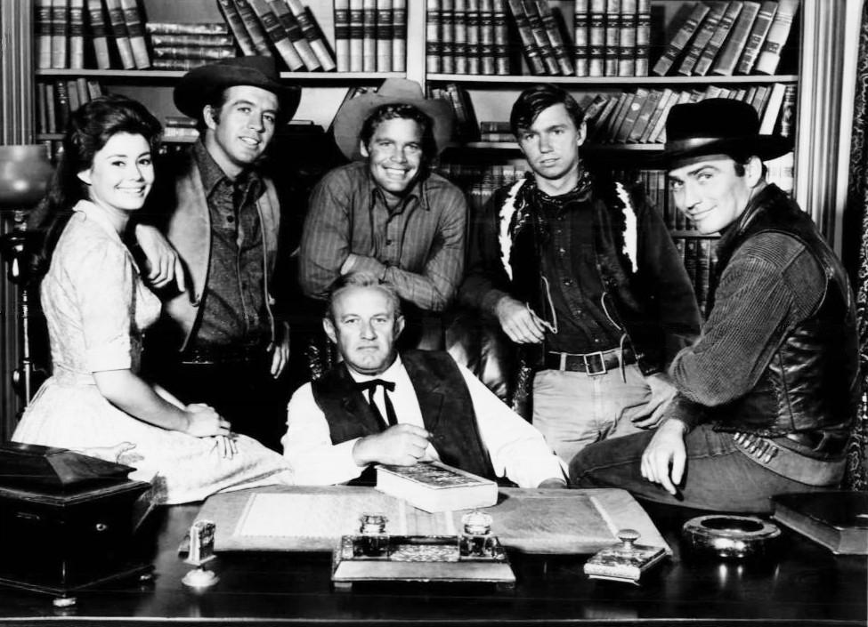 "Roberta Shore (Betsy Garth), Clu Gulager (Emmett Ryker), Doug McClure (Trampas), Randy Boone (ranch hand), and James Drury (The Virginian) in ""The Virginian"" in 1964. 