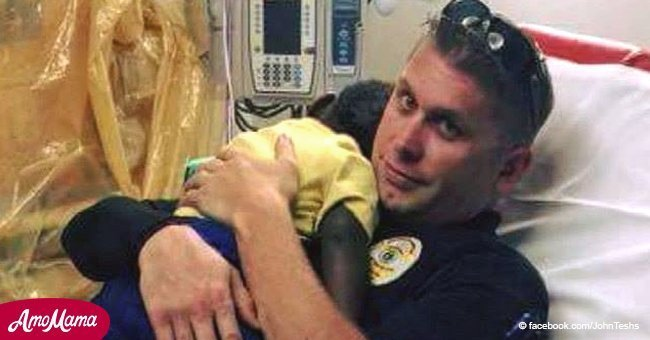 'He needed somebody': Heartwarming photo of police officer comforting little boy went viral