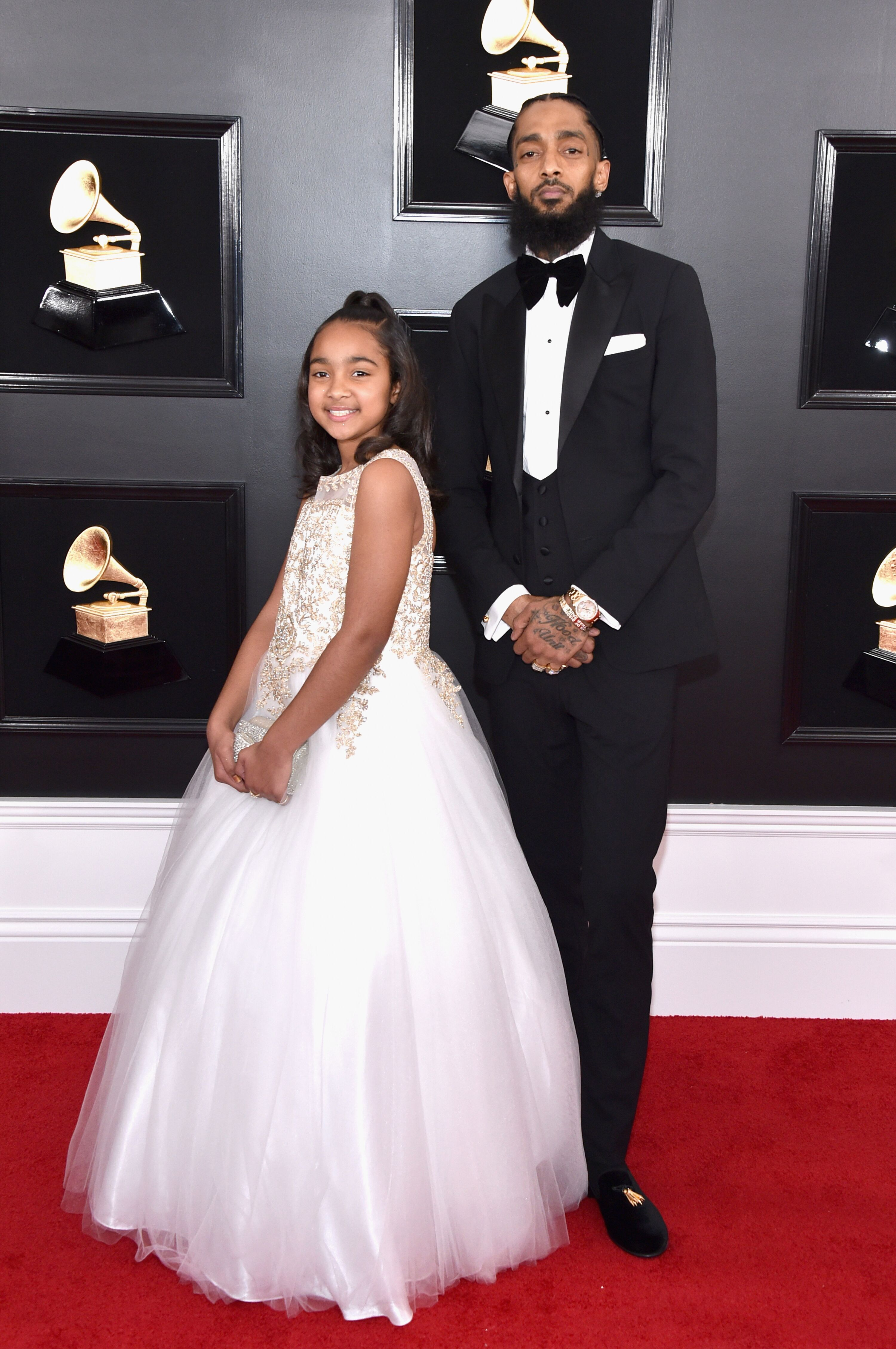 Nipsey Hussle and his daughter Emani Asghedom at the Grammys/ Source: Getty Imgaes
