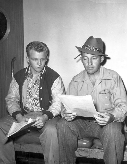 Bing Crosby and Gary Crosby reading a script from Bing's radio program. | Source: Wikimedia Commons