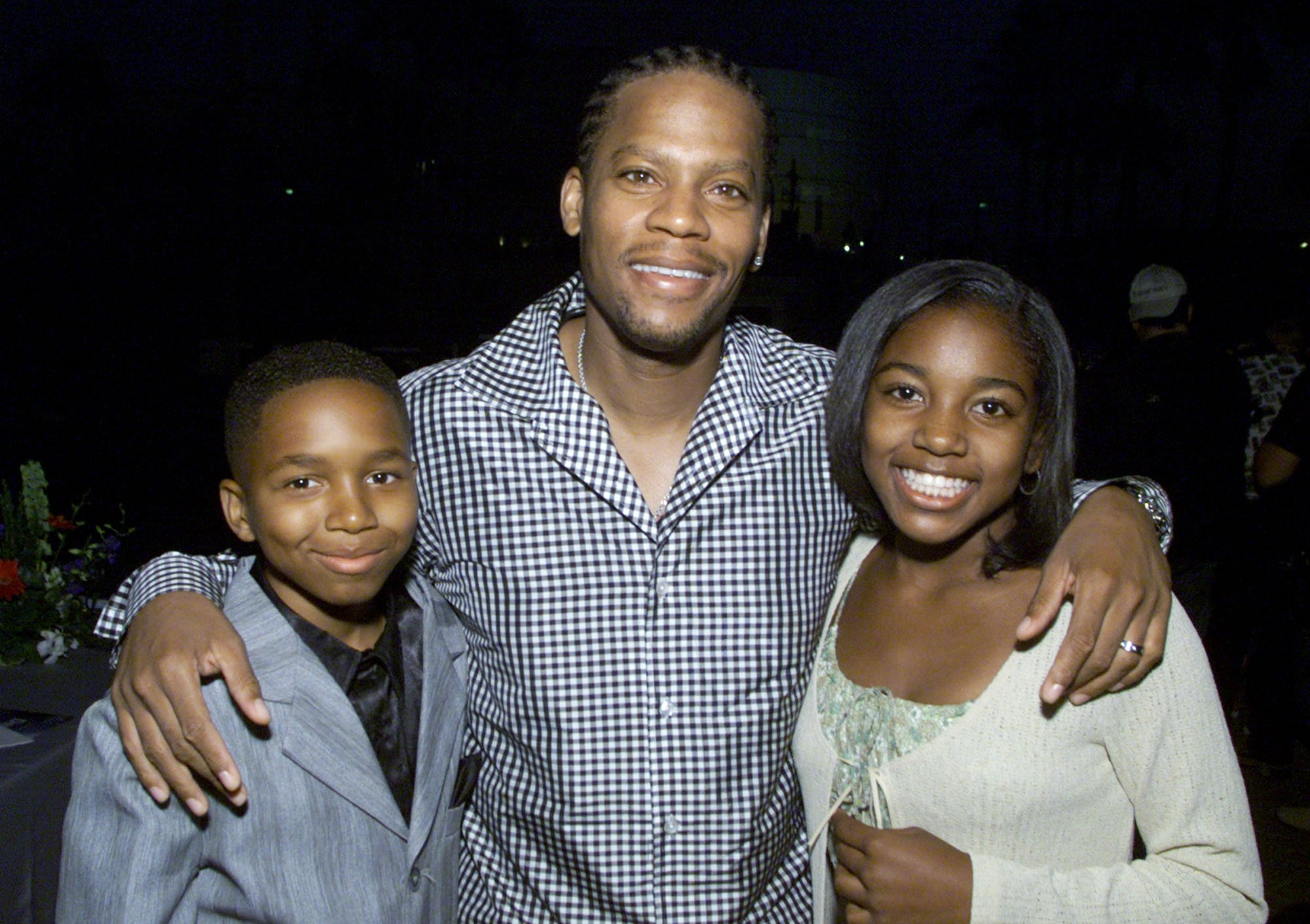 """Stars of """"The Hughleys,"""" Dee Jay Daniels, D.L. Hughley and Ashley Monique Clark at UPN's summer tour party for the Television Critics Association at Paramount Studios in Los Angeles, Ca. on July 16, 2001. 