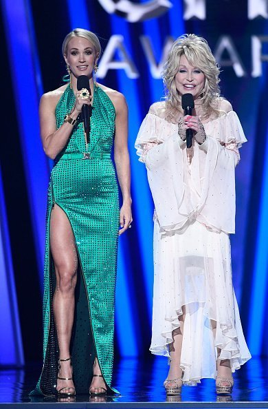 "Carrie Underwood hosts ""The 53rd Annual CMA Awards"" with special guest hosts Reba McEntire and Dolly Parton, celebrating legendary women in Country Music throughout the ceremony 