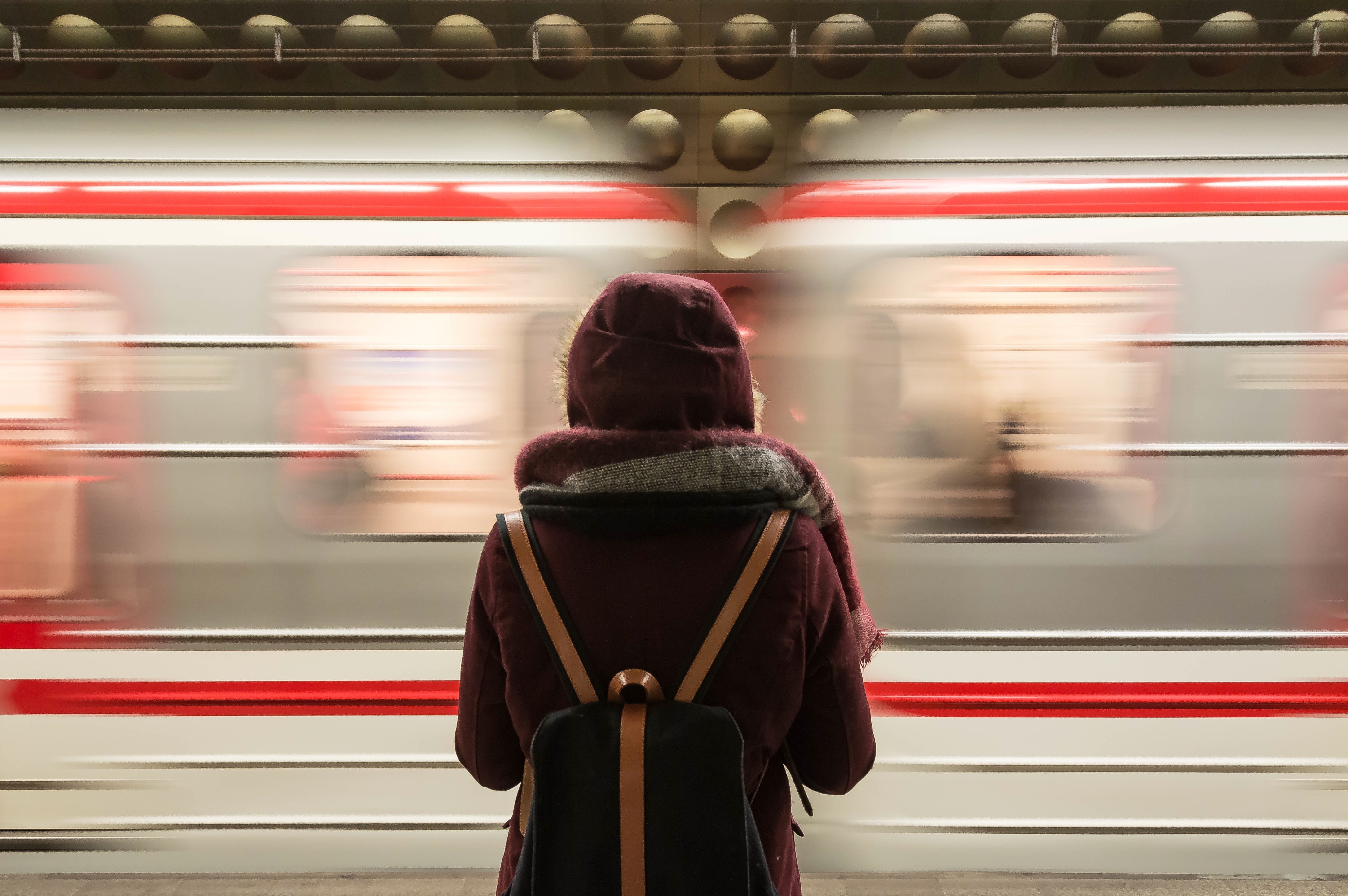 A lady at a train station | Photo: Pexels