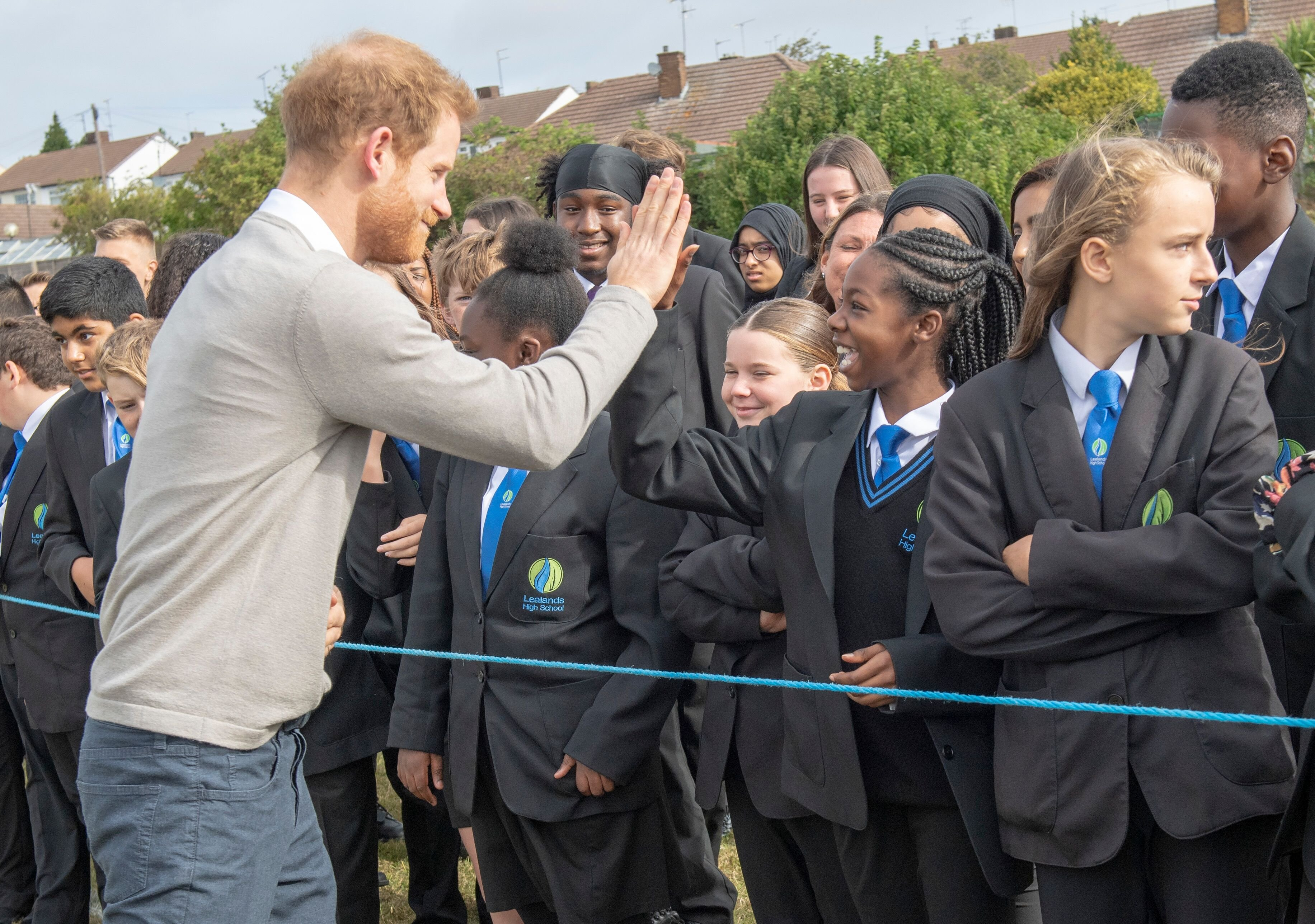 Prince Harry meets pupils during his visit to The Rugby Football Union All Schools Programme. | Source: Getty Images