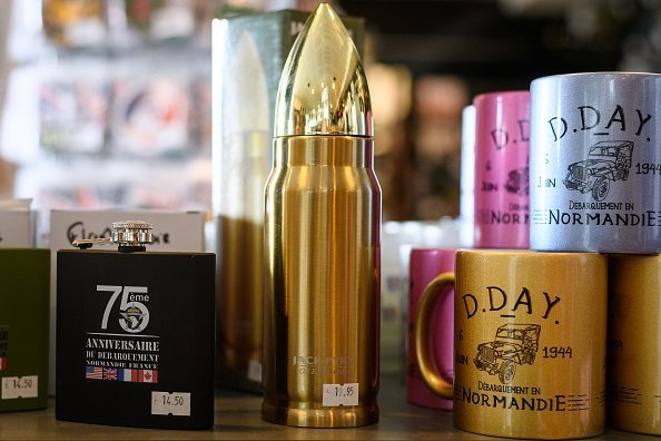 A drinks flask shaped like a bullet is seen in the gift shop of the Utah Beach Museum | Photo: Getty Images