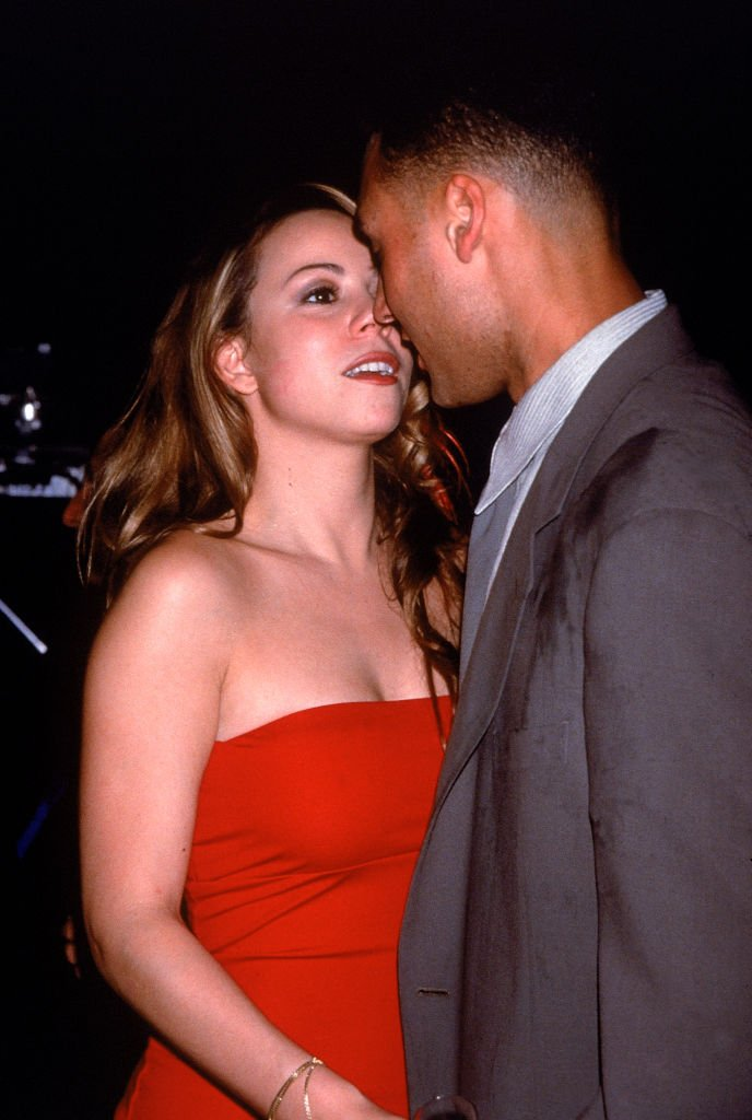 Mariah Carey with then-boyfriend, baseball player Derek Jeter at a birthday party for rapper Puff Daddy on November 4, 1998 | Photo: Getty Images