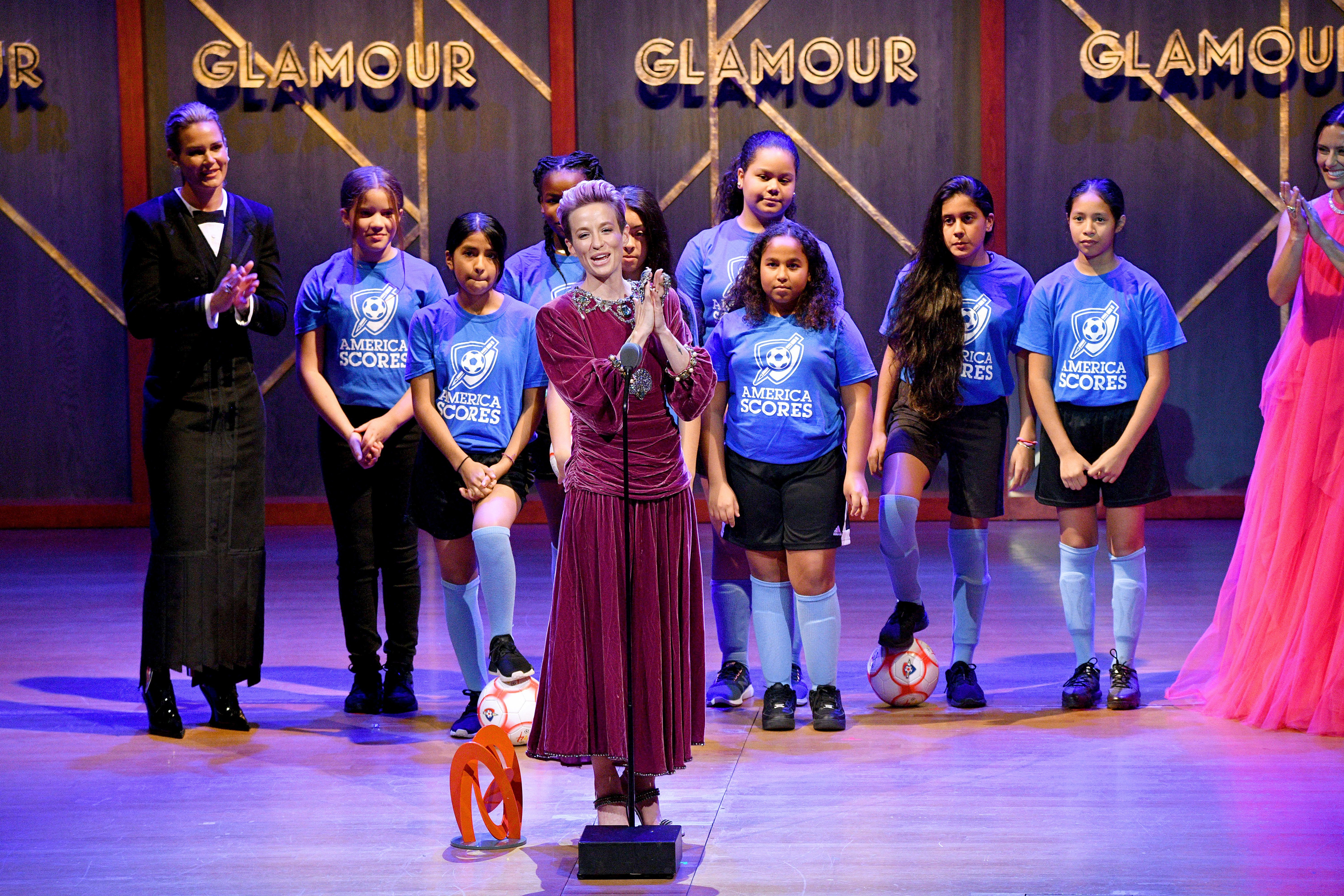 Megan Rapinoe speaks onstage alongside the Mott Hall Girls soccer team at the 2019 Glamour Women Of The Year Awards at Alice Tully Hall on November 11, 2019, in New York City. | Source: Getty Images.
