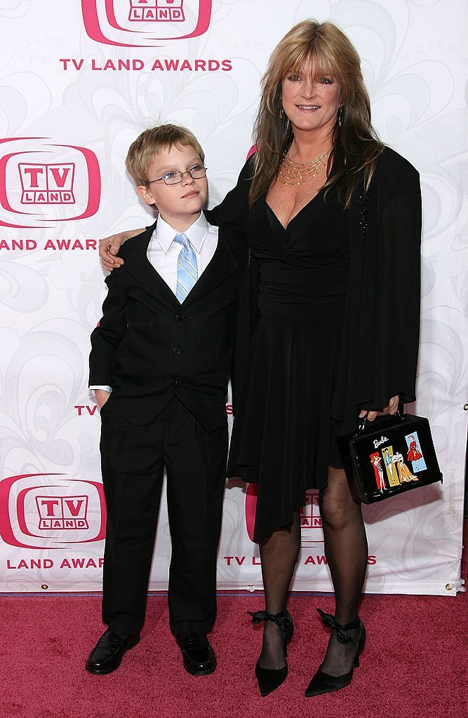 Susan Olsen and her son Micahel Markwell attend the 5th Annual TV Land Awards in Santa Monica, California on April 14, 2007 | Photo: Getty Images