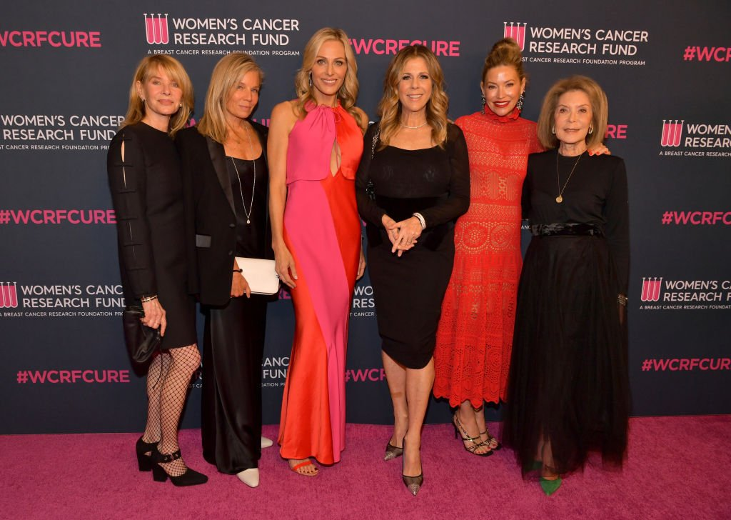 "Kate Capshaw, Kelly Chapman Meyer, Jamie Tisch, Rita Wilson, Myra Biblowit, Quinn Ezralow, and Marion Laurie arrive on the red carpet for the WCRF's ""An Unforgettable Evening"" on February 27, 2020, in Beverly Hills, California 